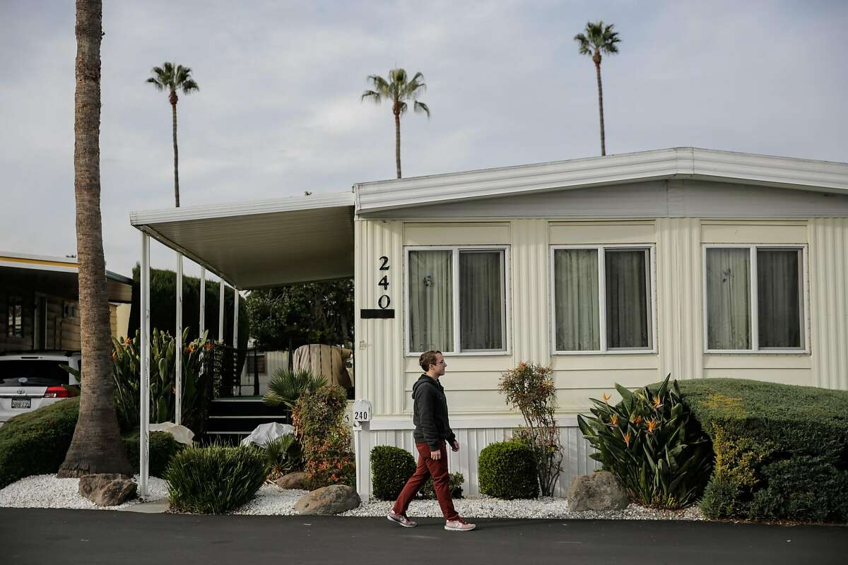 Alexander Brown, a Google employee, walks through the grounds of his mobile home park, in Mountain View, California, on Wednesday, Dec. 7, 2016.