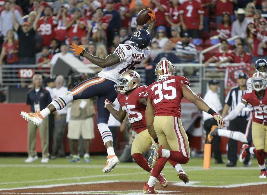 Brandon Marshall with one of his three TDs against 49ers CB Jimmie Ward in 2014. Photo: Marcio Jose Sanchez, Associated Press