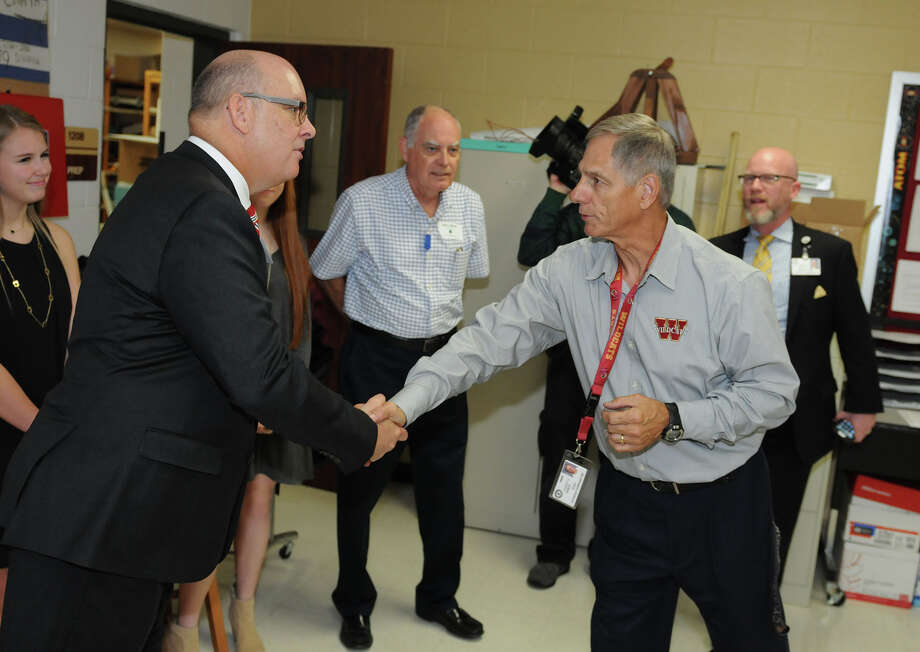 Cypress Woods High School physics teacher Bob Chaya, right, meets District 126 State Rep. Kevin Roberts during School Priority Day.