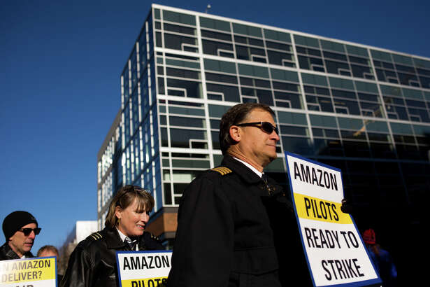 Pilots from Amazon shipping contractor AAWW protest understaffing and contractual delays outside Amazon headquarters in Seattle, Wednesday, Dec. 7, 2016.