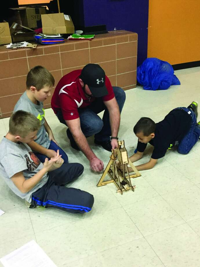 To increase engagement and learning in science, technology, engineering and mathematics, representatives from the Harbor Beach Dow Chemical Company presented a lesson to the third graders at Harbor Beach Elementary School. Students built and tested trebuchets, gathered data and designed further experiments using their trebuchets. (Submitted Photo) Photo: Harbor Beach Community Schools