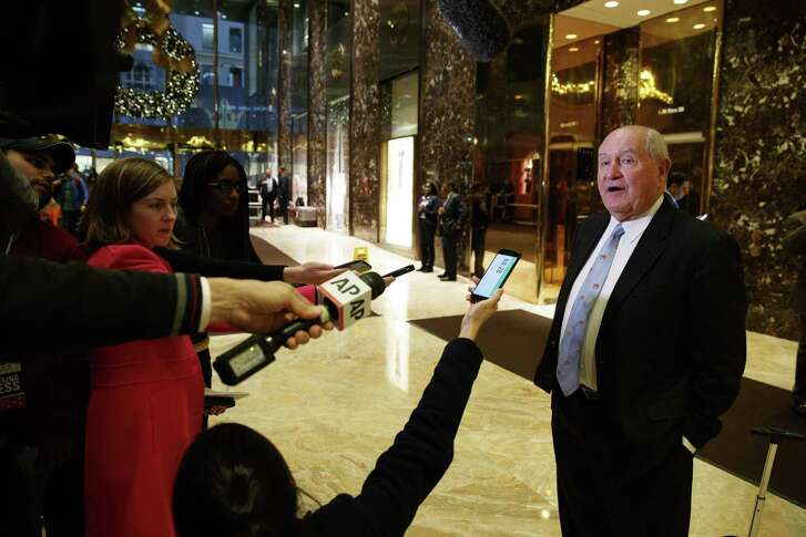 """Former Georgia Gov. Sonny Perdue talks with reporters after meeting with President-elect Donald Trump at Trump Tower, Wednesday, Nov. 30, 2016, in New York. For more than a decade, millions of Americans tuned in to watch Trump interrogate prospective employees on """"The Apprentice"""" with a mix of arrogance and disdain. But in private over the past few weeks, a less theatrical spinoff of the spectacle has unfolded in Trump's office in Manhattan."""