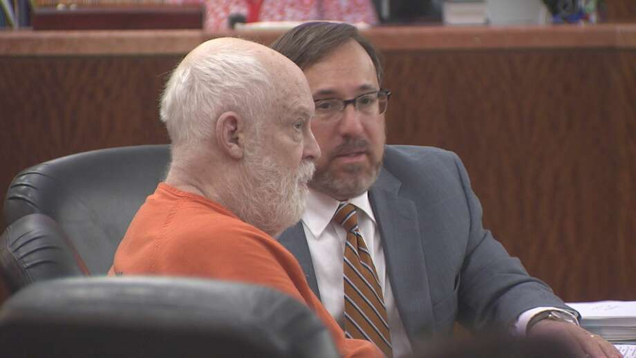 Robert Gillham, 74, is shown with his attorney, Brett Podolsky, in Houston on Wednesday. Gillham is accused of starting a fire that damaged Gallery Furniture's flagship Houston store in 2009. Photo: Brian Rogers, Chronicle