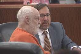 Robert Gillham, 74, is shown with his attorney, Brett Podolsky, in Houston on Wednesday. Gillham is accused of starting a fire that damaged Gallery Furniture's flagship Houston store in 2009.