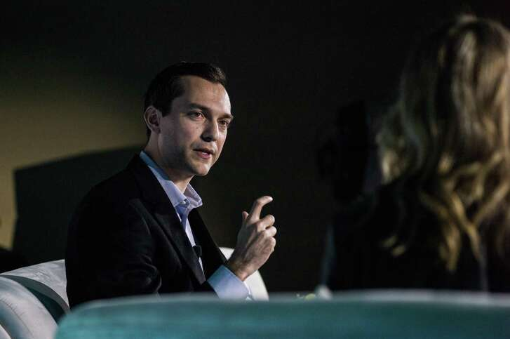 Nathan Blecharczyk, co-founder and chief technology officer of Airbnb Inc., listens during the IGNITION: Future Of Digital Conference in New York, U.S., on Tuesday, Dec. 6, 2016. Airbnb released a report Wednesday laying out its approach to local regulations, trying to capitalize on a weeklong stretch in which it agreed to enforce limits on rentals in London and Amsterdam, dropped a lawsuit against New York City, and praised new rules in New Orleans as a potential nationwide model.