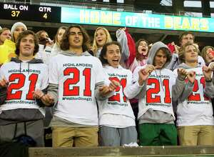 Students from The Woodlands High School sing the school song wearing t-shirts in support of linebacker Grant Milton (21) after the Highlanders' 41-18 win over Round Rock in a Division I Region II-6A final game at McLane Stadium Saturday, Dec. 3, 2016, in Waco. Milton suffered a serious head injury during the team's Nov. 26 win over Austin Bowie in a UIL Class 6A Division I regional semifinal playoff game at Baylor's McLane Stadium. He was taken to a Waco hospital to have emergency surgery where he remains in a medically induced coma.