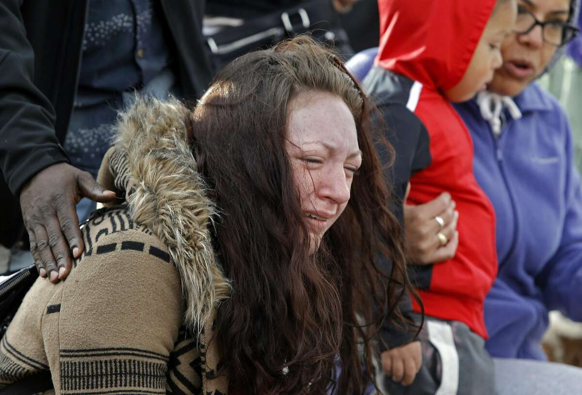Hillary Morse, who lost two friends in the fire gathers with others at a memorial on the corner of International Blvd. and Fruitvale Ave. near the site of the ghost ship warehouse in Oakland, California, on Wednesday December 7, 2016,