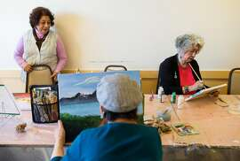 Olinda Marti-Volkoff, a Medicare recipient, (right) works on a painting while taking a class taught by Esperanza Villanuva (left) at the On Lok 30th Street Senior Center in San Francisco, Calif., on Friday, December 2, 2016. She visits the center almost every weekday for classes and to volunteer. House Speaker Paul Ryan has called for changing Medicare from the current plan, where the government pays the bills, to a defined payment plan, where seniors get a certain amount of money to buy private insurance. Studies have shown that likely means higher costs and less coverage for seniors.