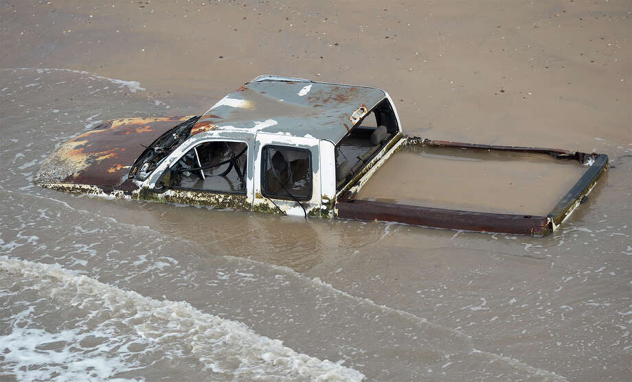 A rusted truck stuck in the surf between Sabine Pass and Bolivar Peninsula. Photo taken Friday, July 15, 2016 Guiseppe Barranco/The Enterprise Photo: Guiseppe Barranco, Photo Editor