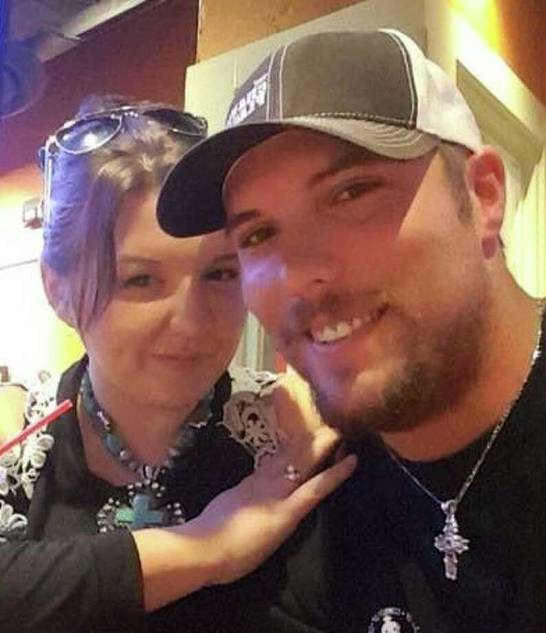 Dusty Tousha is facing a six-month recovery after being run over by a tractor on Dec. 3. Unable to speak and limited to hand-written messages since the accident, Tousha proposed marriage to his longtime girlfriend, Hunter Lisano, and she accepted. Photo: Facebook