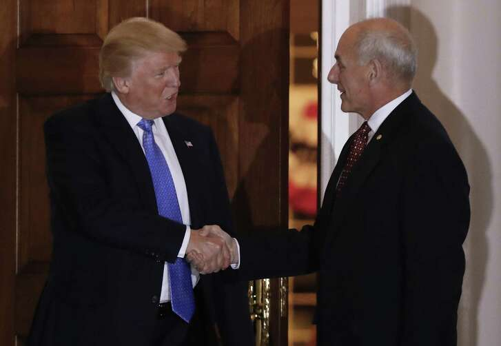 President-elect Donald Trump shakes hands with retired Marine Gen. John Kelly, right, at the Trump National Golf Club Bedminster clubhouse Sunday, Nov. 20, 2016, in Bedminster, N.J.. (AP Photo/Carolyn Kaster)