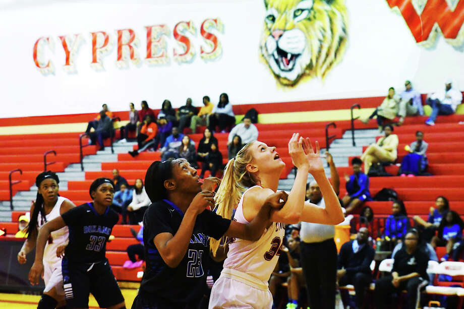 Cy Woods junior forward Cate Reese boxes out for a rebound against Dekaney in a 70-60 loss Tuesday. Despite the loss, Reese enjoyed another strong outing, putting up a game-high 25 points and 17 rebounds. Photo: Tony Gaines / HCN