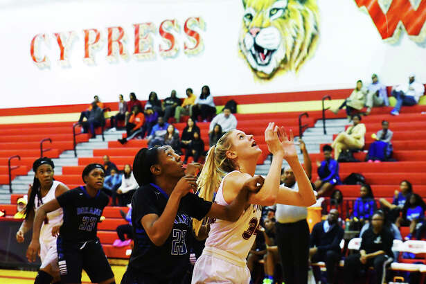 Cy Woods junior forward Cate Reese boxes out for a rebound against Dekaney in a 70-60 loss Tuesday. Despite the loss, Reese enjoyed another strong outing, putting up a game-high 25 points and 17 rebounds.