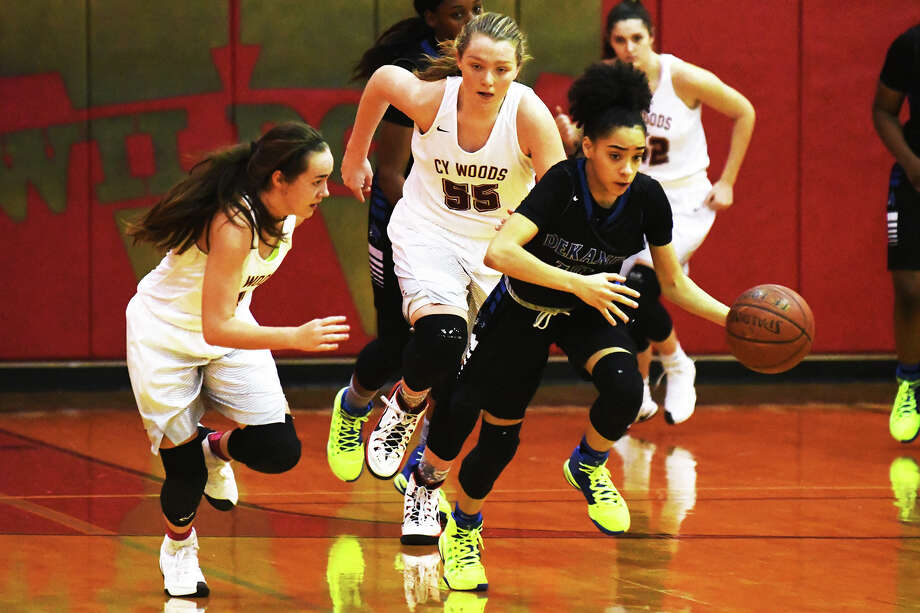Dekaney junior guard Mikayla Capone operates the fast break for the Wildcats Tuesday. Capone was Cy Woods' béªte noire Tuesday, converting on four three-pointers as center Tatyana Hill drew the defense into the paint. Photo: Tony Gaines / HCN