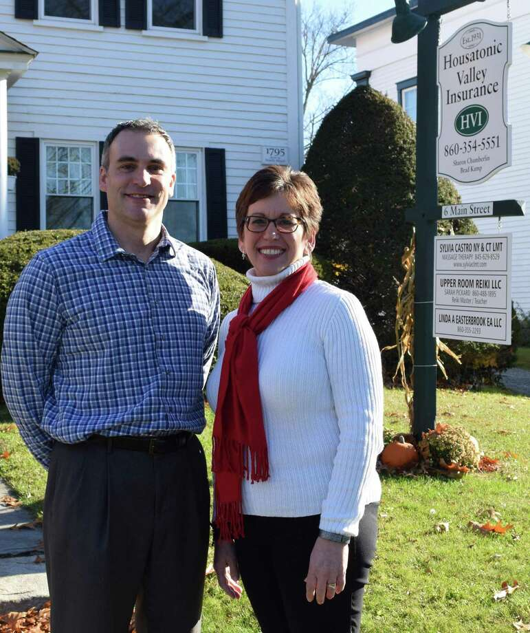 Brad Kamp and Sharon Chamberlin are business partners at Housatonic Valley Insurance in New Milford. Photo: Deborah Rose /Hearst