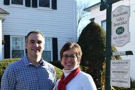 Brad Kamp and Sharon Chamberlin are business partners at Housatonic Valley Insurance in New Milford.