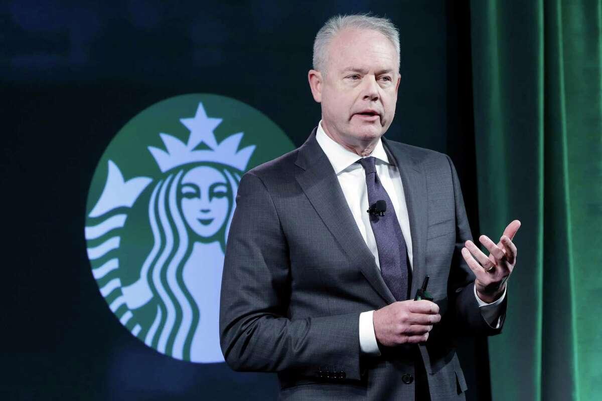 Kevin Johnson, Starbucks' chief operating officer, talks to investors in New York in December 2016.
