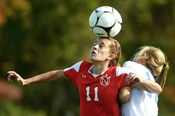 Niskayuna's Olivia Piraino, left, beats Shaker's Janina Rudzinski to the header during their soccer game on Saturday, Oct. 15, 2016, at Shaker High in Latham, N.Y. (Cindy Schultz / Times Union)