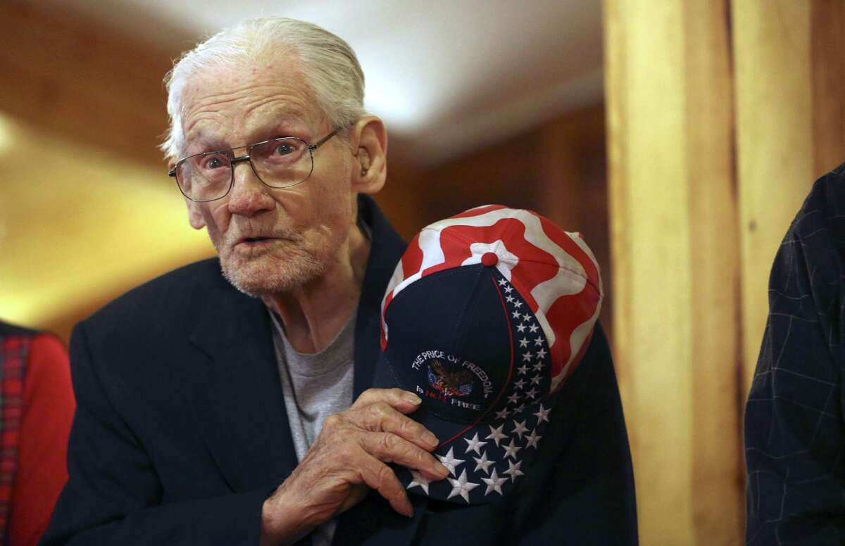 Pearl Harbor Survivor Machinist Mate John Buchanan says the benediction Wednesday, Dec. 7, 2016 during a luncheon for San Antonio's Pearl Harbor Survivors. Wednesday was the 75th anniversary of the Japanese surprise attack. Fewer than 10 survivors are still alive in San Antonio; four of them made it to the luncheon.
