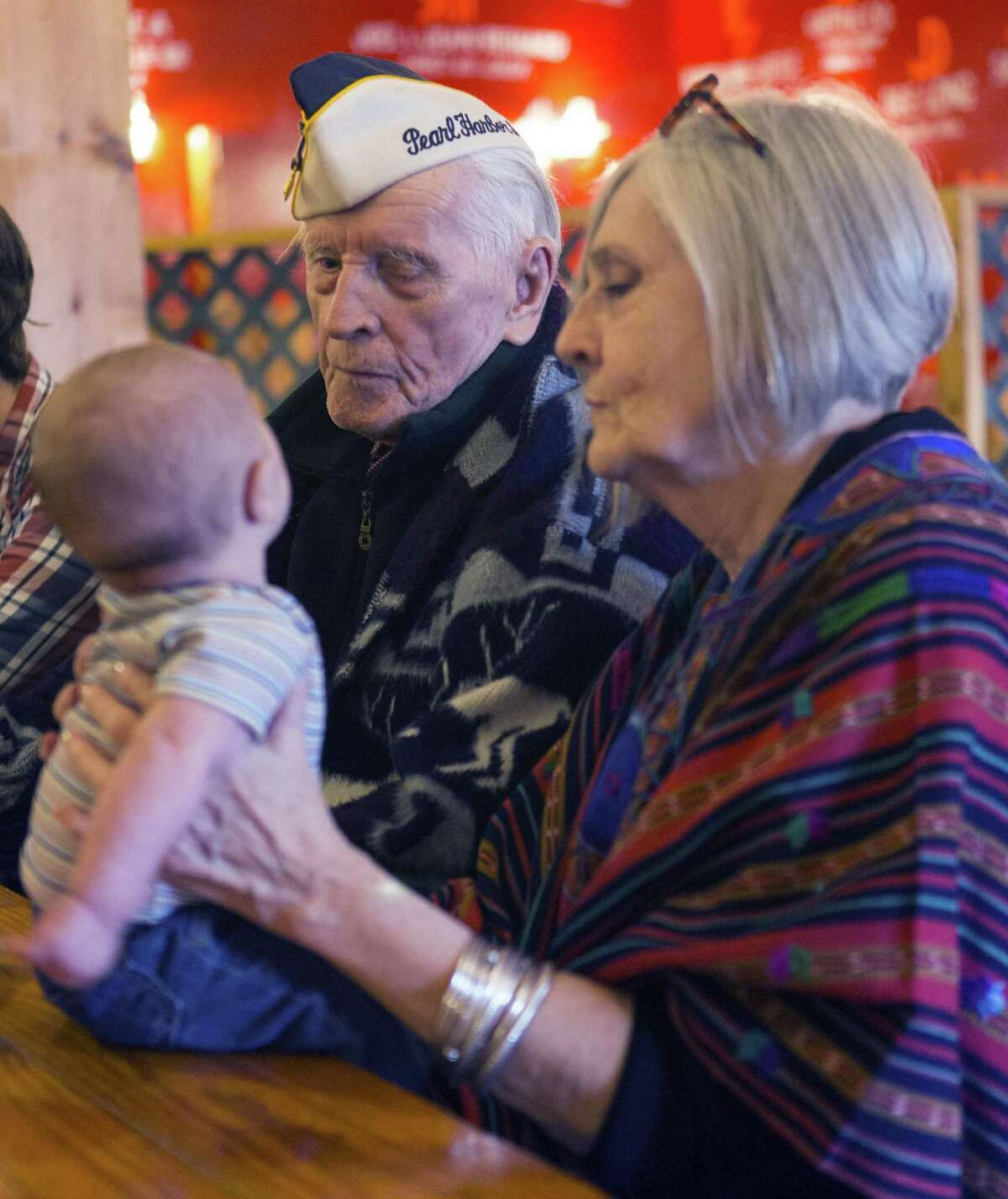 Pearl Harbor Survivor Air Force Maj. Richard Anderson, looks Wednesday, Dec. 7, 2016, toward his great, great grandson Silas Graviss who is being held by Anderson's daughter Sharon Gregory during a luncheon for San Antonio's Pearl Harbor Survivors. Wednesday was the 75th anniversary of the Japanese surprise attack. Fewer than 10 survivors are still alive in San Antonio; four of them made it to the luncheon.