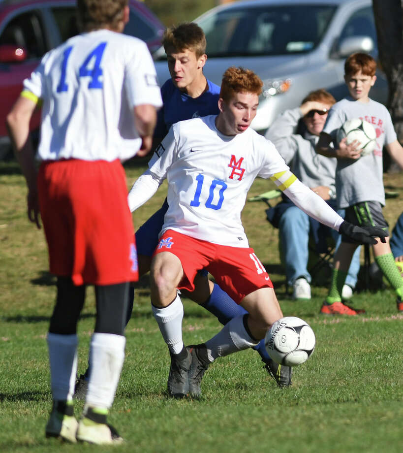 Maple Hill senior striker Garrett Axtmann,#10, handles the ball during a soccer game against Galway on Monday, Oct. 10, 2016 in Castleton-on-Hudson, N.Y. (Lori Van Buren / Times Union) Photo: Lori Van Buren / 20038338A