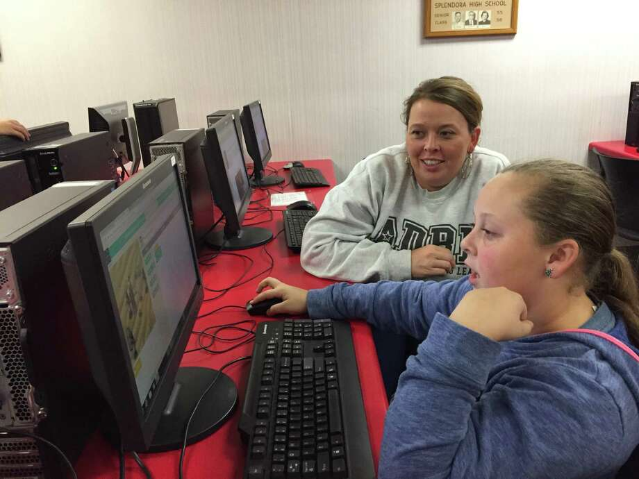 Sheila Walker, right, watches as her daughter Katherine Walker, a fifth-grade student at Greenleaf Elementary in the Splendora Independent School District, participates in the Hour of Code on Tuesday evening. Hour of Code is an event held annually to encourage people to learn computer programming. Photo: Julie Silva