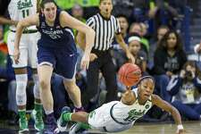 Notre Dame's Lindsay Allen (15) dives for a loose ball in front of Connecticut's Natalie Butler (51) during the first half of an NCAA college basketball game, Wednesday, Dec. 7, 2016, in South Bend, Ind. (AP Photo/Robert Franklin)