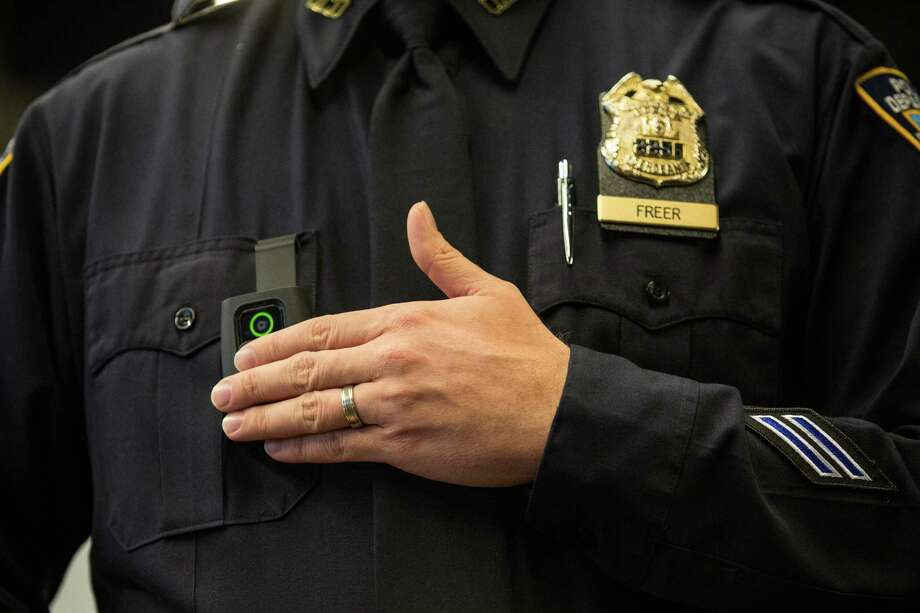 NEW YORK, NY - DECEMBER 03:  New York Police Department (NYPD) Sergeant Joseph Freer demonstrates how to use and operate a body camera during a media press conference on December 3, 2014 in New York City. The NYPD is beginning a trial exploring the use of body cameras; starting Friday NYPD officers in three different precincts will begin wearing body cameras during their patrols.  (Photo by Andrew Burton/Getty Images) ORG XMIT: 526710405 Photo: Andrew Burton / 2014 Getty Images