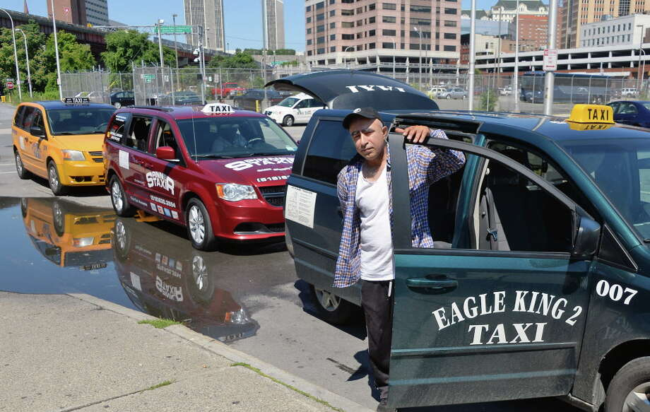 Eagle King 2 Taxi driver Sayed Qasem and his 007 cab await fares at the Greyhound Bus terminal on Hamilton Street Wednesday, Aug. 3, 2016, in Albany, NY.  (John Carl D'Annibale / Times Union) Photo: John Carl D'Annibale / 20037527A