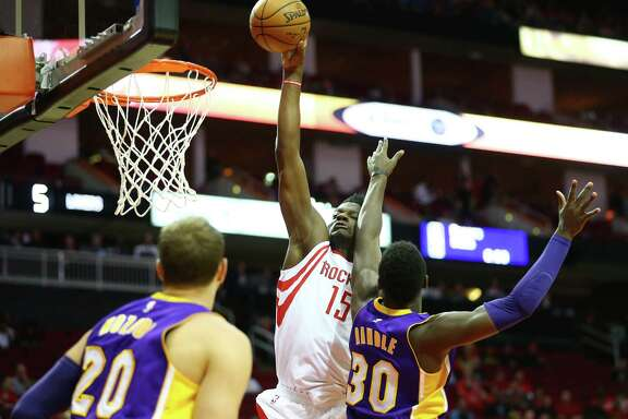 Houston Rockets center Clint Capela (15) drives to the basket past Los Angeles Lakers forward Julius Randle (30) during the first quarter of an NBA game at the Toyota Center, Wednesday, Dec. 7, 2016, in Houston.