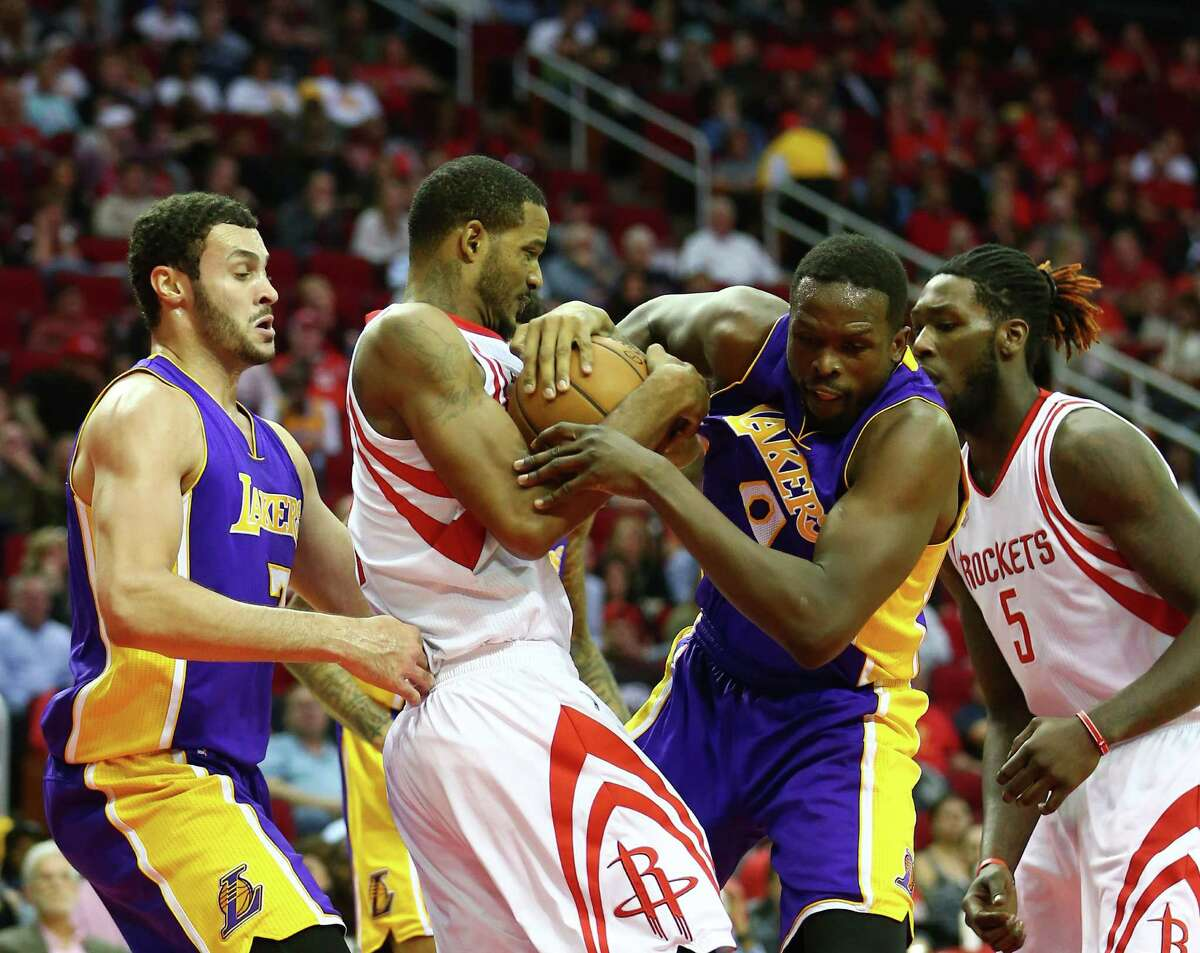 Houston Rockets forward Trevor Ariza (1), second from left, gets tangled up with Los Angeles Lakers forward Larry Nance Jr. (7), left, and forward Luol Deng (9), second from right, during the second quarter of an NBA game at the Toyota Center, Wednesday, Dec. 7, 2016, in Houston.