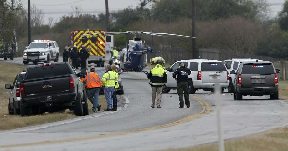 Bexar County Sheriff's deputies work at the scene on the 7900 block of Gibbs Sprawl Road where according to sheriff's spokesman James Keith, a 16-year-old Judson High School Junior was hit and killed by a Union Pacific train on some nearby railroad tracks. Photo: John Davenport, Staff / San Antonio Express-News / ©San Antonio Express-News/John Davenport