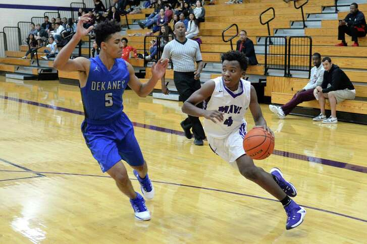 L J Cryer (4) of Morton Ranch dribbles around Dekaney's D J Peavy (5) in the first half of a boys basketball game between the Morton Ranch Mavericks and Dekaney Wildcats during the Katy ISD-Phillips 66 Tournament on Thursday December 1, 2016 at Morton Ranch, Katy, TX.