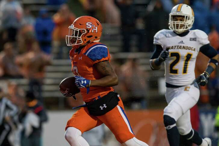 Yedidiah Louis, left, burns Chattanooga for the third of his touchdown receptions in Sam Houston State's second-round 41-36 victory Saturday.