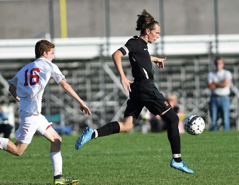 Bethlehem's Kevin Piccolino kicks the ball down the field before scoring during a soccer game against Niskayuna on Tuesday, Sept. 27, 2016 in Niskayuna, N.Y. (Lori Van Buren / Times Union) Photo: Lori Van Buren / 40038180A