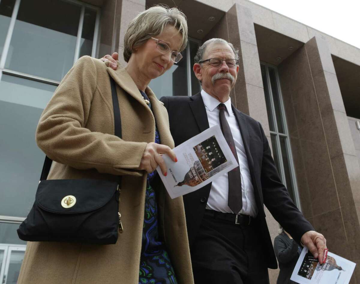 Mickey Redus, right, and his wife Valerie Redus leave the Texas Supreme Court in Austin, TX, on Wednesday, Dec. 7, 2016, after a hearing of arguments in the wrongful death of their son Cameron Redus against the University of the Incarnate Word.