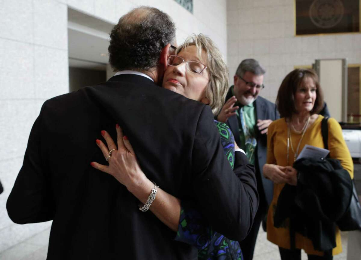 Valerie Redus hugs her husband, Mickey, outside the Texas Supreme Court after a hearing of arguments in the wrongful death of their son Cameron Redus against the University of the Incarnate Word.