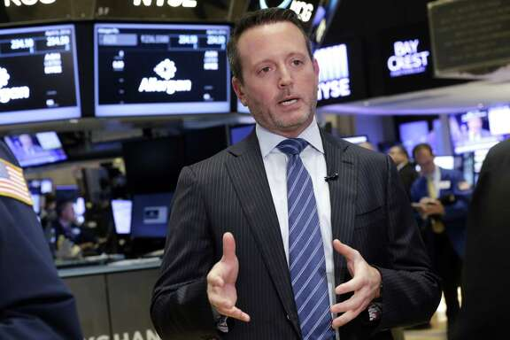 Allergan CEO Brent Saunders is interviewed on the floor of the New York Stock Exchange, Wednesday, April 6, 2016. (AP Photo/Richard Drew)
