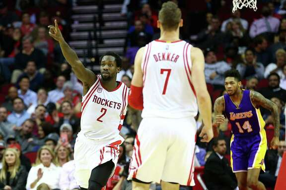 Houston Rockets guard Patrick Beverley (2) celebrates after scoring during the fourth quarter of an NBA game at the Toyota Center, Wednesday, Dec. 7, 2016, in Houston.