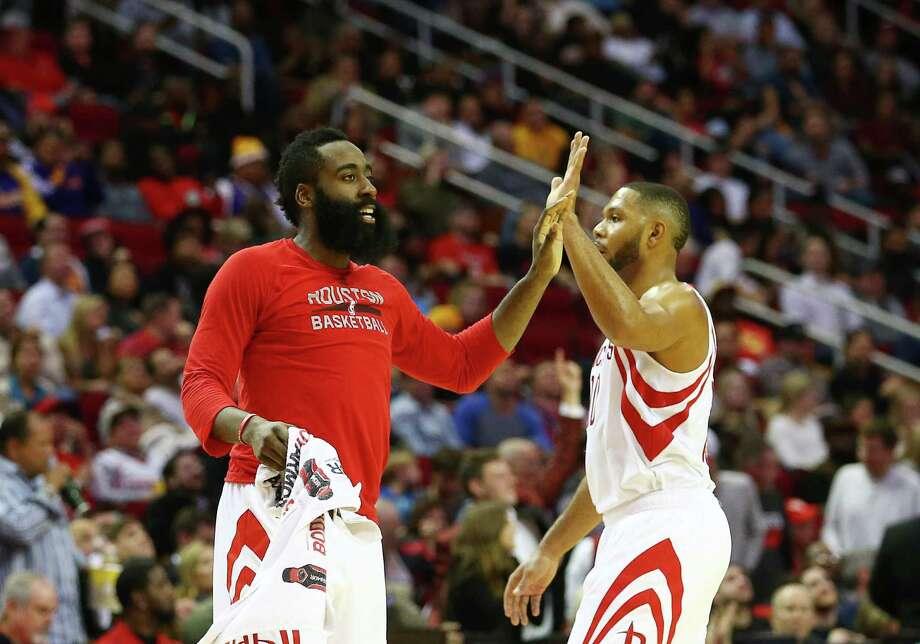 Houston Rockets guard James Harden (13) high-fives  guard Eric Gordon (10) during the fourth quarter of an NBA game at the Toyota Center, Wednesday, Dec. 7, 2016, in Houston. Photo: Jon Shapley, Houston Chronicle / © 2015  Houston Chronicle