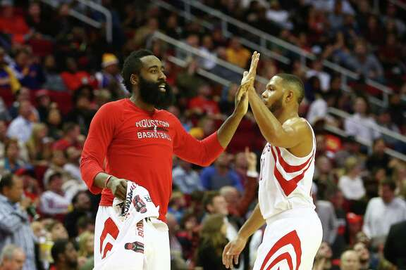 Houston Rockets guard James Harden (13) high-fives  guard Eric Gordon (10) during the fourth quarter of an NBA game at the Toyota Center, Wednesday, Dec. 7, 2016, in Houston.