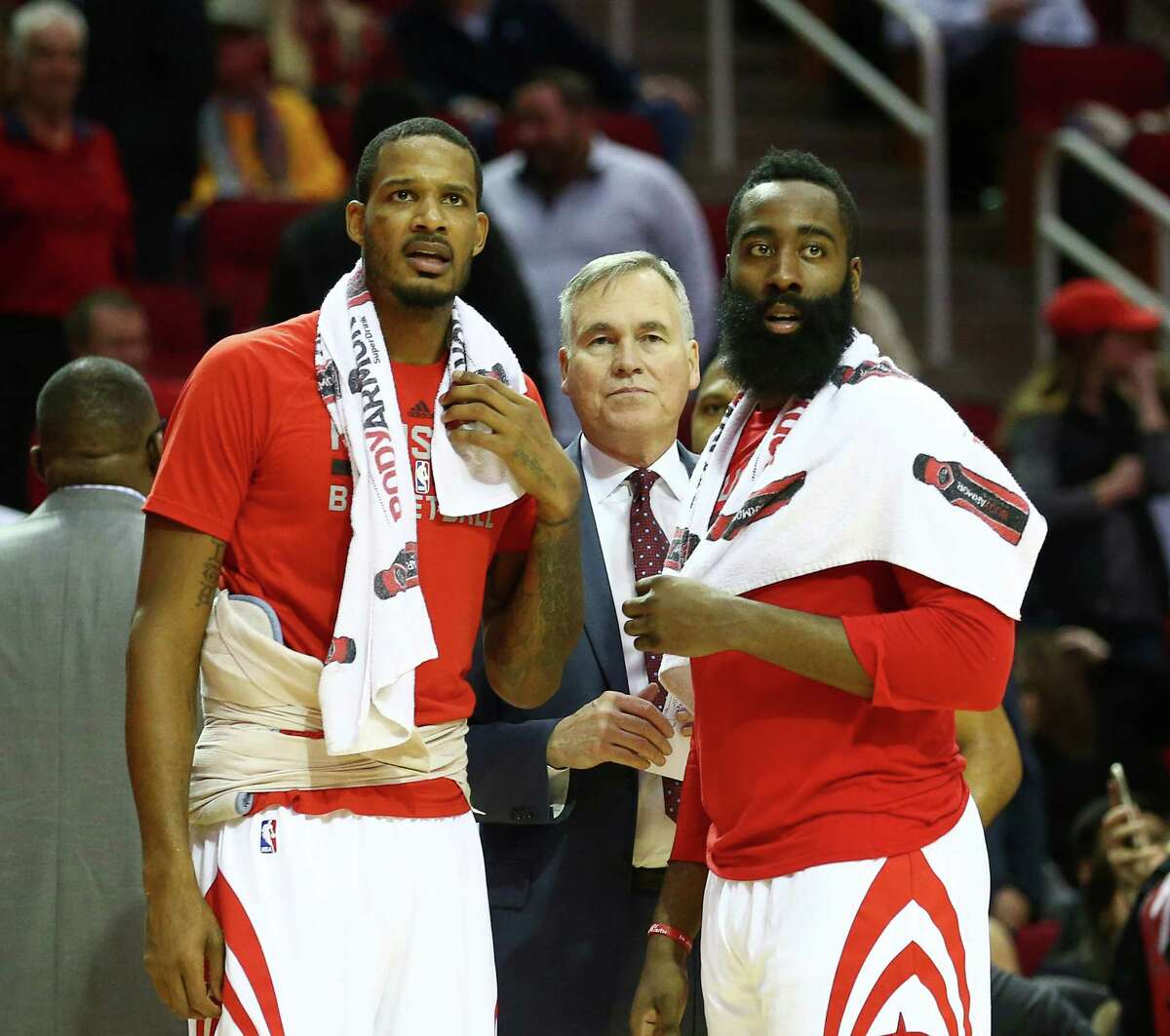 Houston Rockets head coach Mike D'Antoni, center, talks with forward Trevor Ariza (1), left, and guard James Harden (13) during the fourth quarter of an NBA game at the Toyota Center, Wednesday, Dec. 7, 2016, in Houston.