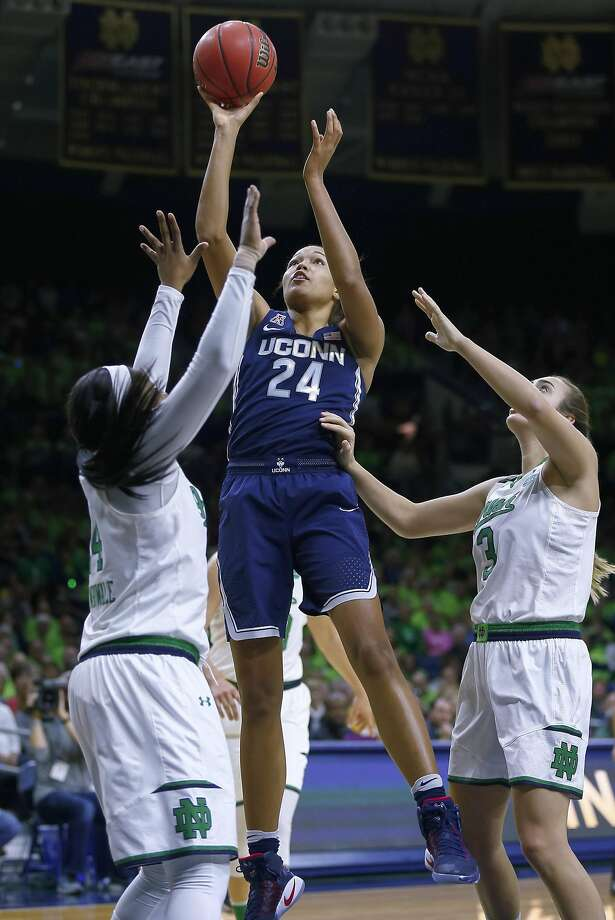 High scorer Napheesa Collier of Connecticut finds room to shoot against Notre Dame's Arike Ogunbowale (left). Photo: Michael Hickey, Getty Images