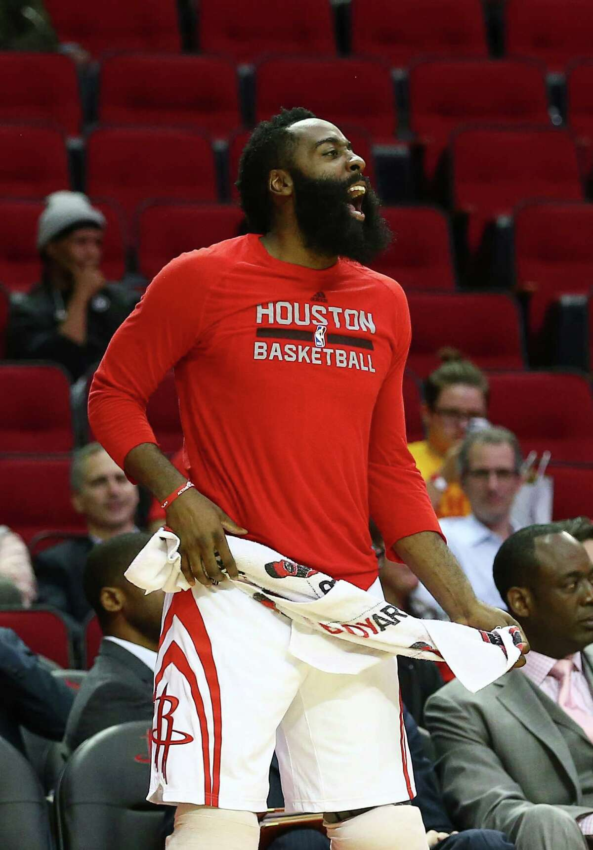 Houston Rockets guard James Harden (13) celebrates during the fourth quarter of an NBA game at the Toyota Center, Wednesday, Dec. 7, 2016, in Houston.