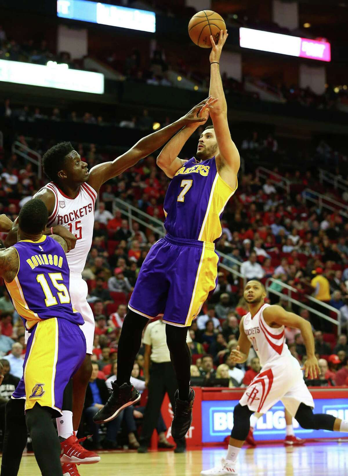 Los Angeles Lakers forward Larry Nance Jr. (7) takes a shot while Houston Rockets center Clint Capela (15) under pressure from during the third quarter of an NBA game at the Toyota Center, Wednesday, Dec. 7, 2016, in Houston.