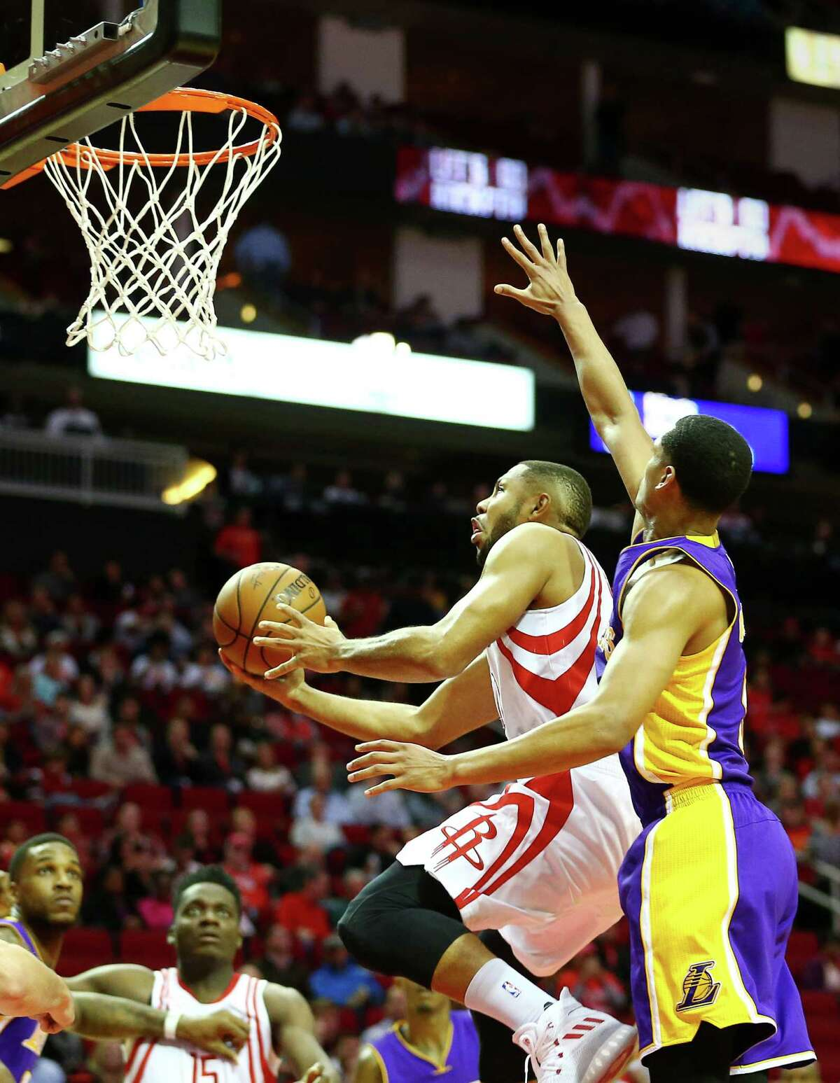 Houston Rockets guard Eric Gordon (10) drives to the basket while under pressure from Los Angeles Lakers guard Jordan Clarkson (6) during the second quarter of an NBA game at the Toyota Center, Wednesday, Dec. 7, 2016, in Houston.