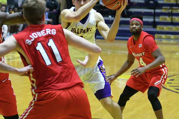 UAlbany's Joe Cremo looks for an opening during their men's college game against Marist at the SEFCU Arena on Wednesday Dec. 7, 2016 in Albany, N.Y. (Michael P. Farrell/Times Union)