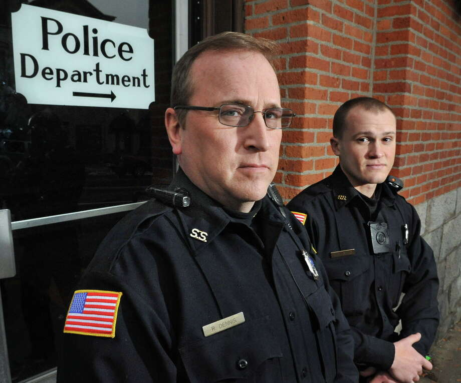 Saratoga Springs patrolmen Robert Dennis, left, and Mickey Bezio wear their department's body cams Tuesday Dec. 9, 2014, in Saratoga Springs, NY. Officer Dennis has a pencil sized unit attached to his uniform epaulette, Officer Bezio's unit is attached to the chest of his uniform shirt.  (John Carl D'Annibale / Times Union) Photo: John Carl D'Annibale / 00029778A