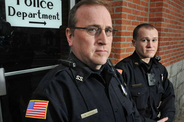 Saratoga Springs patrolmen Robert Dennis, left, and Mickey Bezio wear their department's body cams Tuesday Dec. 9, 2014, in Saratoga Springs, NY. Officer Dennis has a pencil sized unit attached to his uniform epaulette, Officer Bezio's unit is attached to the chest of his uniform shirt.  (John Carl D'Annibale / Times Union)