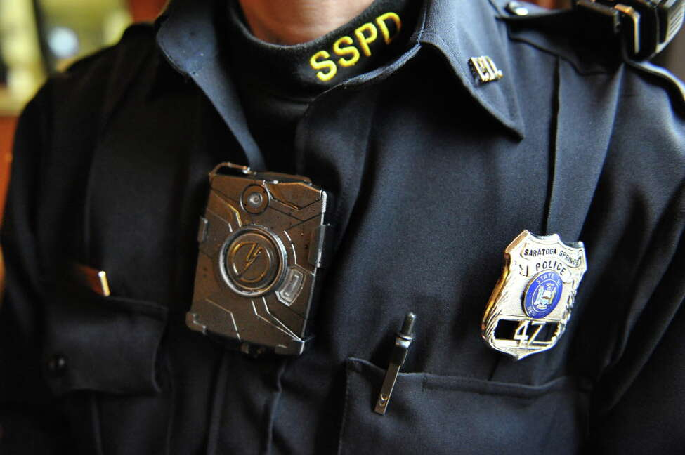 Saratoga Springs patrolman Mickey Bezio wears one of his department's body cams attached to the chest of his uniform shirt Tuesday Dec. 9, 2014, in Saratoga Springs, NY. (John Carl D'Annibale / Times Union)